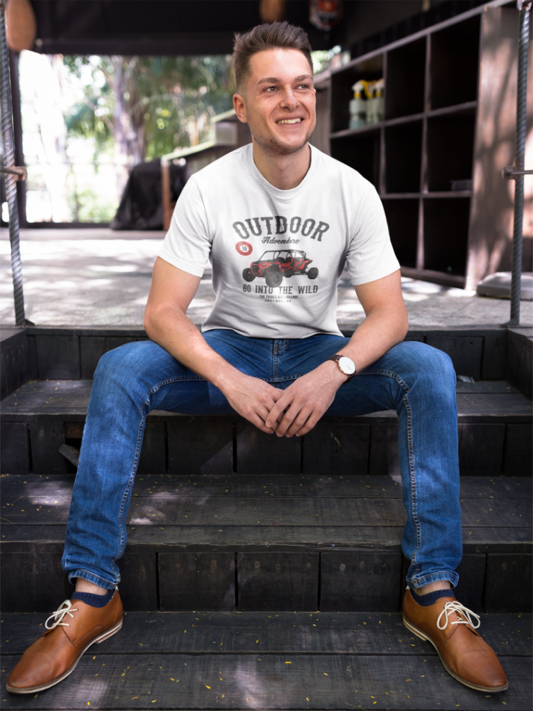 happy guy wearing a tshirt template while sitting on steps outdoors a17850