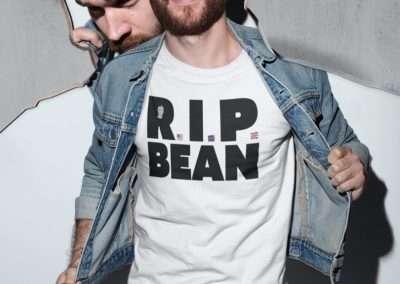 man with beard wearing a RIP Bean t shirt and a denim jacket