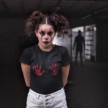 mockup of a woman wearing a t shirt with a shadow man standing behind her 22928