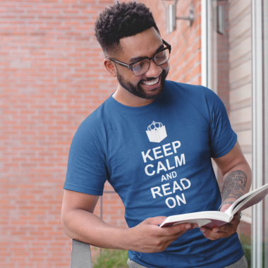 tshirt mockup of a smiling man reading in a balcony 21338